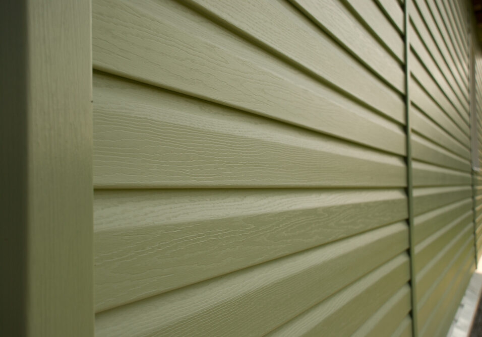 Siding wall of building in perspective closeup  in the daytime outdoors